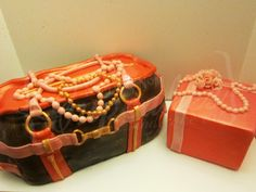 A dual-designer inspired purse cake accompanied by a pink giftbox! The purse is chocolate cake filled with peanut butter cream cheese mousse with crushed butterfinger candybar bits and covered with chocolate marshmallow fondant. The giftbox cake is a strawberry vanilla bean cake with coconut lime mousse filling and covered with strawberry fondant. NOMNOM!