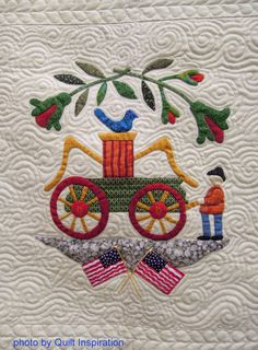 """Fireman block, in: Album Quilt by Louise Robertson, quilted by Karolyn """"Nubin""""Jensen.  Photo by Quilt Inspiration."""