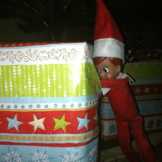 Elf on the Shelf idea! Peaking in a present!!