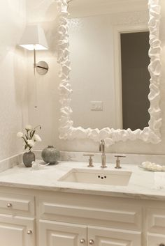 Powder bathrooms - white rectangular mirror, lucite sconce, built in vanity, built in washstand, white marble countertop, marb...