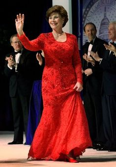 Laura Bush made a bold statement in this red gown by Dallas designer Michael Faircloth. (AJC.com) #GWInaugural 2000-2008.  A very good dress for her.