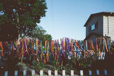 ribbon garland, photo by Bethany Carlson http://ruffledblog.com/a-handcrafted-backyard-wedding-in-sunnydale #weddingideas #garlands