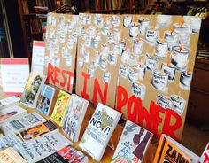 Current Events: Women & Children First, Chicago, Ill., created a window display in response to the events in Ferguson, Mo., following the death of Michael Brown on August 9. The paintings were created by bookseller Jill Kuanfung. via Shelf Awareness