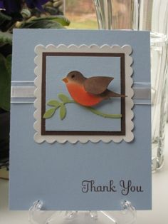 handmade card ... Stampin' Up!  Bird Punch  decorated as a robin ... lovely card ...Nancy Amato  Robin by karen.x ... pastel blue with large scalloped square focal point ...