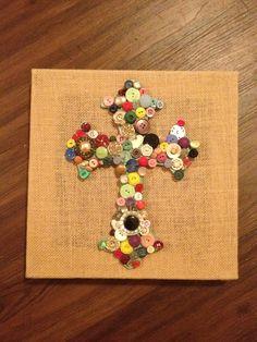 Button cross on burlap canvas
