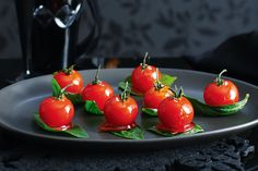 Candied tomatoes on basil leaves http://www.taste.com.au/recipes/21613/candied+tomatoes+on+basil+leaves