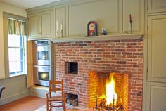 hidden double oven with recessed doors doors, amaz kitchen, coloni fireplac, hidden oven, cooking, bricks, kitchen renovations, farmhous kitchen, faux fireplac