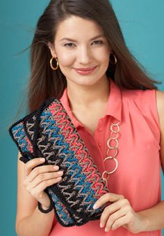 Free crochet pattern. Inspired by Florentine Bargello needlework, this chic purse shines with any outfit. Shown in Patons Grace.