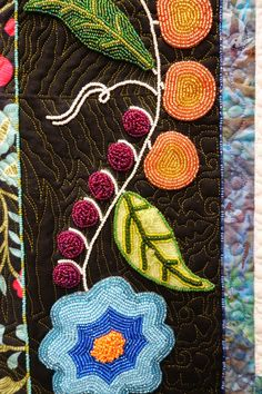"""""""Ojibwe Jingle"""" quilt by T Carter (Virginia).  Beadwork. Traditional Annishinaabe beadwork from the 1890s inspired the designs.  Photo by Sew Fun 2 Quilt: More Quilts from the Denver 2014 Show"""