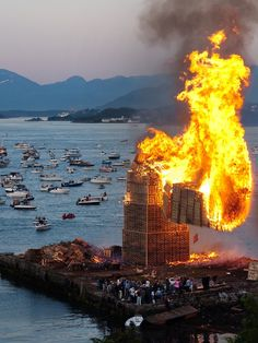 To see the world's biggest bonfire you'll have to visit Alesund, Norway, where wood pallets are stacked over 40 meters (131 ft) high on an artificial island. The occasion? Sankthans, or 'Midsummer', an annual festival in commemoration of John the Baptist's birth. The day is celebrated on the 24th of June (around summer solstice) in Scandinavian countries and other parts of Europe.