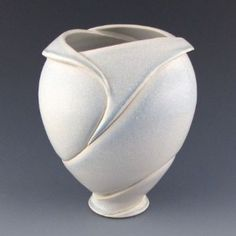 handmade contemporary sculptural ceramic vase Judy Tavill organic curves art nouveau lines It is wheel-thrown on the pottery and altered by cutting and carving, and refining the porcelain in a sophisticated sculptural manner. clay, handmade pottery, fold vase, ceram vase, potteri life, potteri inspir, medium vase, art nouveau, juditavil
