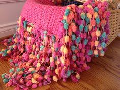 Crochet photo prop blanket pink with rainbow Pom Pom fringe via Etsy