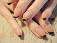 haven't seen this design before. asymetrical nails with jewel. might look cute as a pedicure