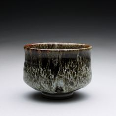 Stoneware tea bowl with layered tenmoku and white glazes https://www.etsy.com/shop/rmoralespottery