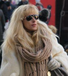 Stylish lady wearing white mink coat.  Prague street style