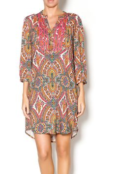 Multicolored paisley 3/4 tunic dress with pink trimed front and gold button detailing. Available in-store at the bird & the bee or online at Shoptiques!