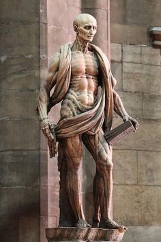St Bartholomew, an early Christian martyr who was skinned. If you look closely, you'll notice that's not a robe, but actually his removed skin hanging around him.          by Marco d'Agrate, 1562 (Duomo cathedral, Milan-Italy)