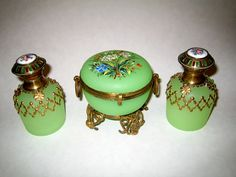 French 19th Century green opaline glass perfume bottles and a green opaline glass box