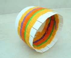 Cute DIY for weaving baskets using yarn and re-used plastic containers.