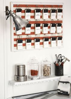Binder clip bulletin board  All you need for this fun idea to keep business cards organized are binder clips, a small tackboard, striped paper, and pushpins.