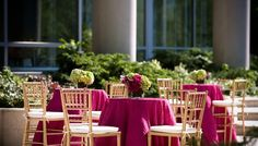 Pink tablecloths add a splash of color to this chic outdoor wedding reception! {2941 Restaurant}