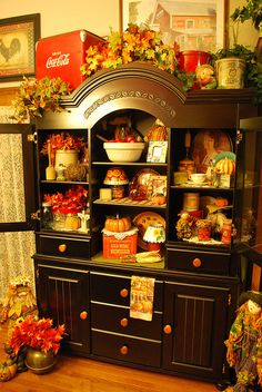Black hutch decorated for fall