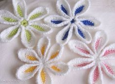 "I found these flowers for inspiration and I am personally calling them: ""Snow Dusted Flowers"" and they are going on my tree! The pattern is from a book called Crochet Bouquet by Suzann Thompson. I don't have the book but I know I can do this! ¯\_(ツ)_/¯"