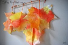 Beautiful Fall Craft: Coffee Filter Leaves. Perfect for talking about fall colors! #preschool #kidscrafts #efl #education (pinned by Super Simple Songs)