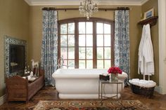 one way to do curtains over an arched window