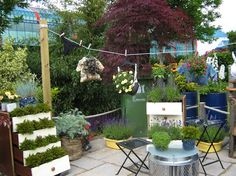 Put up a small clothes line to showcase hanging baskets and other neat plant containers.