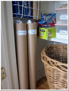 re-use plastic bags and store them in cardboard tubes of all sizes to keep them under control. I use mailing tubes to store plastic grocery bags and paper towel tubes to hold smaller produce size bags. The big basket on the floor is for large bags.