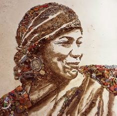 Vik Muniz - saw a documentary about this, he created portraits of people who sorted through the garbage dumps in Brazil.  The portraits were huge and made out of the garbage.