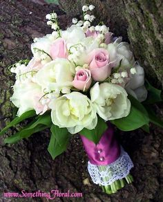 Petite spring bouquet of pink roses, ivory tulips, and white lily of the valley, hand-tied and wrapped with deep mauve satin ribbon and a touch of feminine lace. Design: Something Floral  Photo: Urban Fire Studio #bridal #bouquet #rose #tulip #lilyofvalley #wedding #flowers