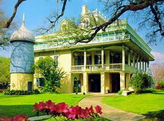 "one of the major sites of the New Orleans area. Constructed between 1849-50, the San Francisco Plantation House is one of the most ornate of Louisiana's plantation houses. San Francisco, with its potpourri of architectural designs, its immense and ornate roof construction, and the paintings decorating the ceilings and door panels in the house's parlors, exemplifies the ""steamboat Gothic"" style"
