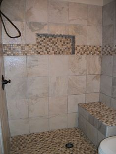 Walk-in shower with niche and bench