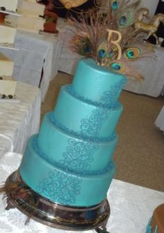 cake. wedding cake toppers, peacock feathers, peacock wedding, peacock theme, wedding cakes, blue cakes, romantic weddings, future wedding, birthday cakes