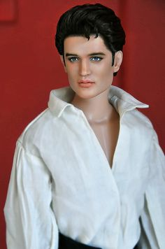 Young Elvis Presley doll