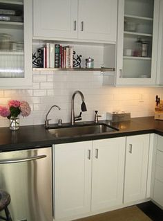 Bookshelf idea for above the kitchen sink - recipe book storage??