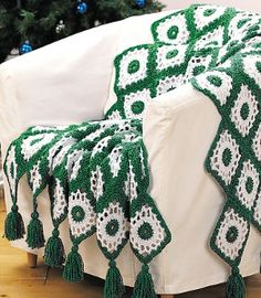 When the Christmas bells start ringing, you'll want to have a cozy crochet afghan to keep you warm. The Old Fashioned Evergreen Crochet Blanket Pattern will do just that and add a festive flair to your home this holiday season.