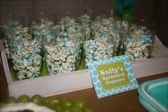 monsters inc party ideas :: sullys sprinkled popcorn ♥{sully's sprinkled popcorn} popcorn tossed with melted white chocolate and sprinkles served in a cup to make it easy to grab and go!