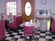 Summer Nites is a step back to the '50s  The box car diner is complete with a 1953 Seeburg #Jukebox, neon lighting and diner booths. #diner #pink #checker #blackandwhite #tile #retro