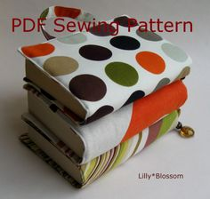Book Bag Sewing Guide. Looks very simple, like making a book cover out of fabric, but with handles and a bookmark attached!