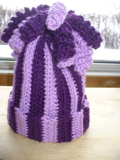 Purple Child's Hat with Curly Q's $20.00