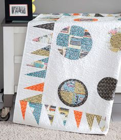 Writer's Block: This modern quilt pattern by Tia Curtis uses a fun technique for appliqué–it's like creating port holes on your quilt! Pick interesting quilt fabric prints to make this quilt from the July/August 2013 issue of Love of Quilting extra special!