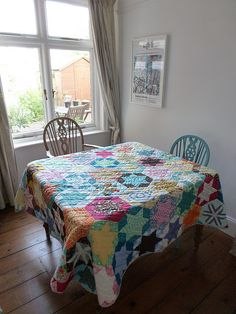 Quilt used as tablecloth. Cool!