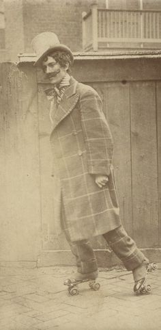 Man in theatrical costume roller-skating on a sidewalk. (1910)