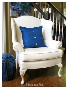 Instead of reupholstering this wing chair fabric was painted with an acrylic paint (Lowe's French Linen) and fabric medium mixture