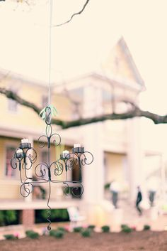 wire chandelier using bale wire and tea lights