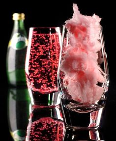 Fill glass with pink cotton candy and slowly pour Lime Perrier over it. Such a beautiful nonalcoholic beverage.