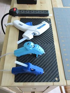 Use silicon pot holder as glue gun mats. Use a surge protector to plug in a lamp & glue gun. When the lamp is on so is the glue gun. Safely.